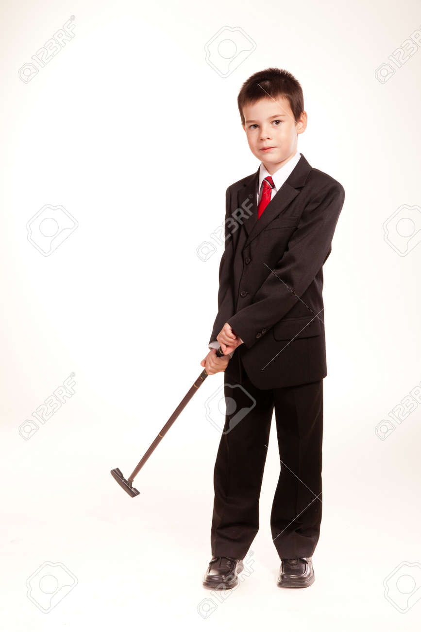3aa61a653aa5 Stock Photo - Young boy posing in studio in a black suit and a red tie,  business code, isolated on white