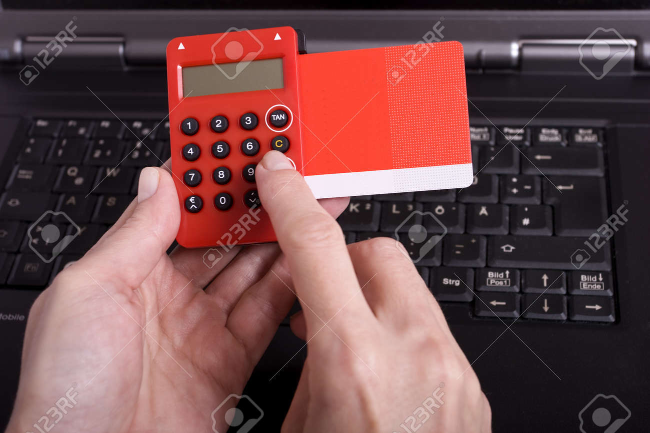 realization of payment through a TAN Generator Stock Photo - 12062915