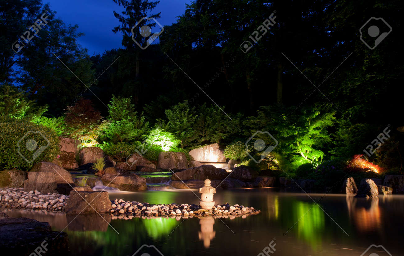 Waterfall In Japanese Garden At Night Stock Photo Picture And