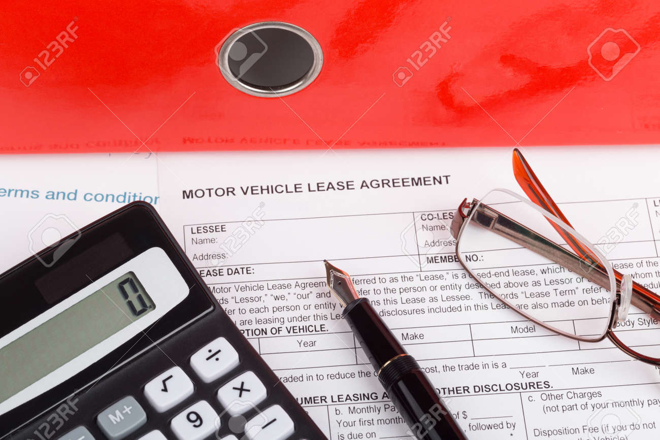 motor vehicle lease agreement with fountain pen and calculator stock photo 49135054