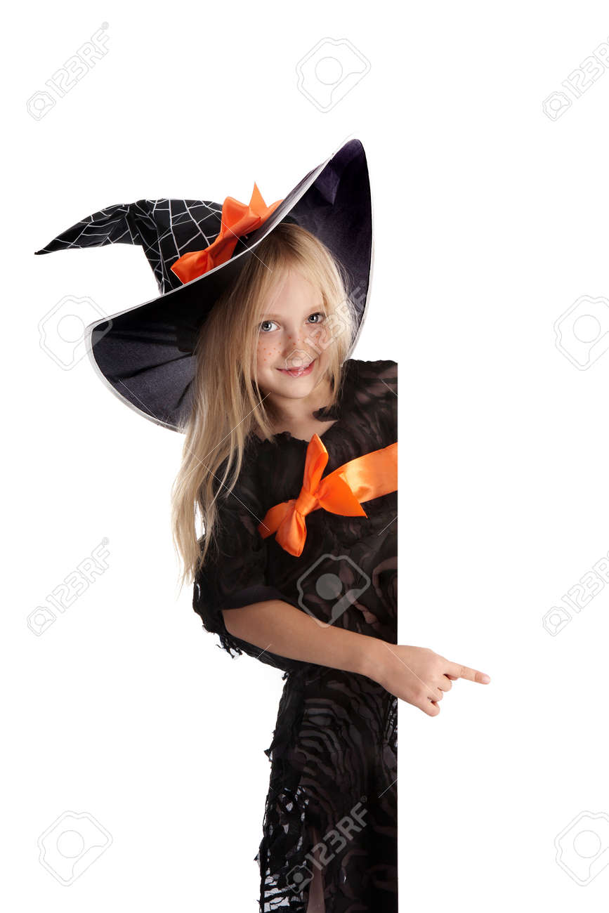Beautiful Smiling Little Girl with Long Blonde Hair in the Witch Costume Pointing the Sign .  sc 1 st  123RF.com & Beautiful Smiling Little Girl With Long Blonde Hair In The Witch ...
