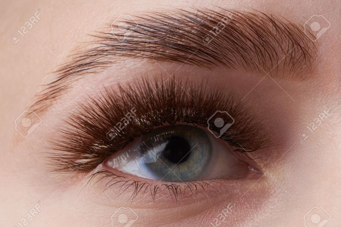 Beautiful macro photography of a woman's eye with extreme make-up of long eyelashes. Perfect long eyelashes. without cosmetics. Close-up fashion eye visage, lamination eyebrow beautiful - 122431047