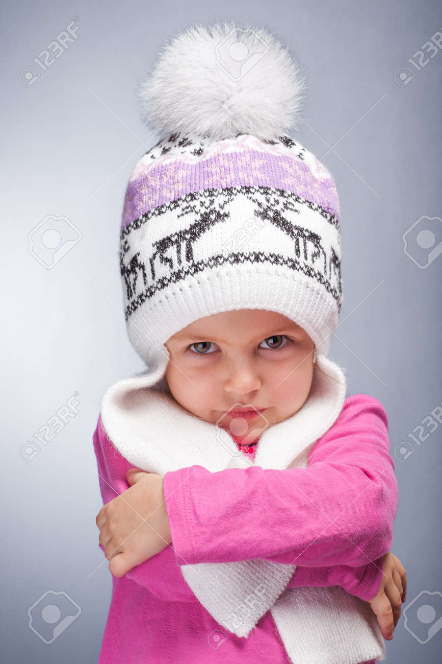 02bd4dc6b Portrait Of An Adorable Baby Girl Wearing A Knit Pink And White ...