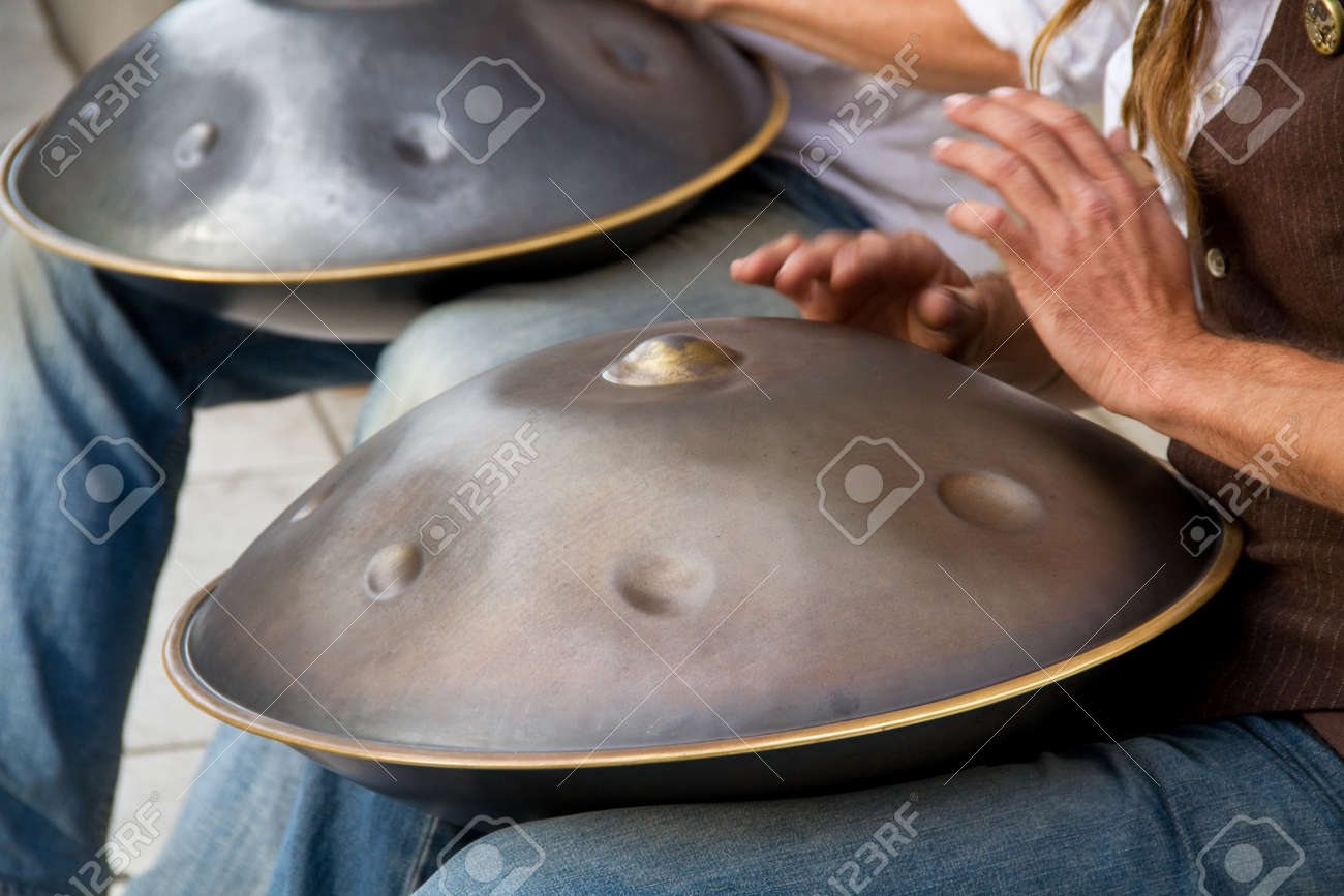 Two buskers play on the Swiss musical instrument - hang Stock Photo -  12345594