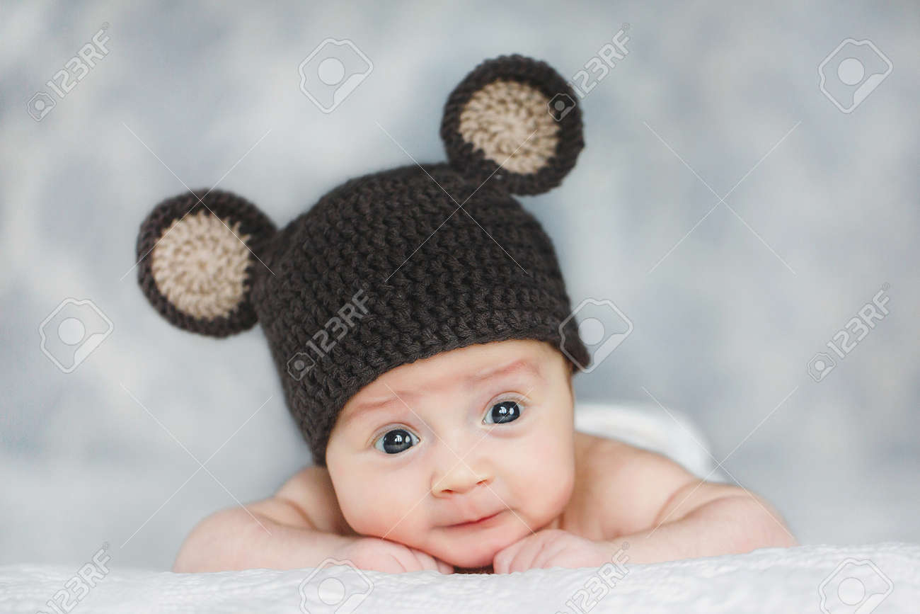 6c954d98b22a portrait of adorable Cute newborn baby boy in knitted hat Stock Photo -  27495290