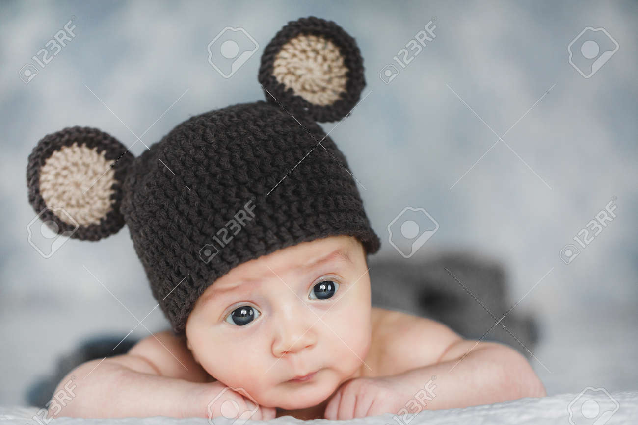 870521a61 portrait of adorable Cute newborn baby boy in knitted hat