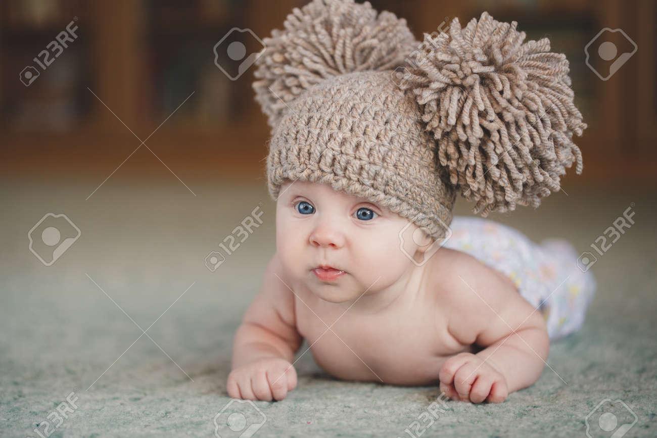 4f2dd3026d06 Cute newborn baby girl. Portrait of a cute 3 months baby lying down on a