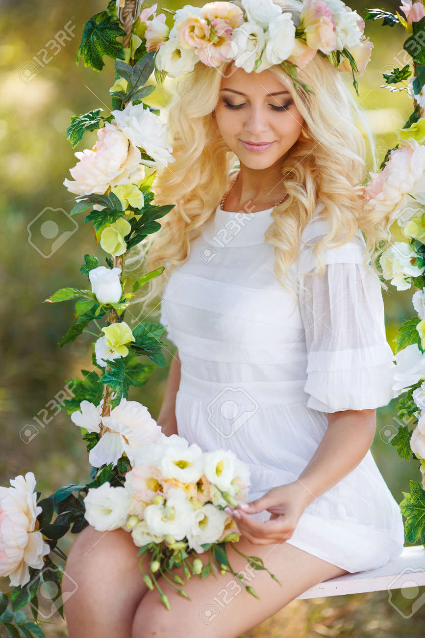 Blue Eyed Bride With A Beautiful Blond Curly Long Hair In A White