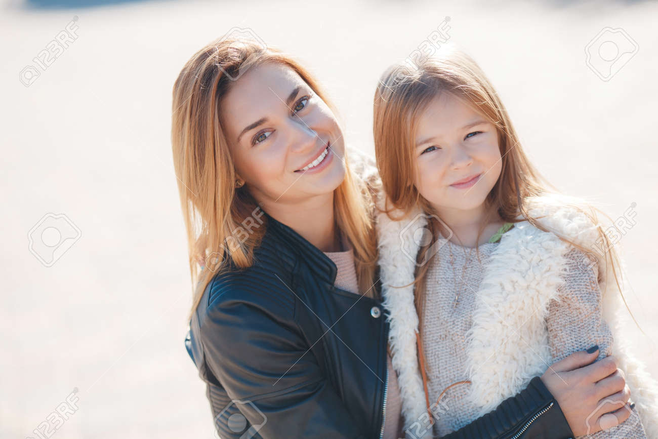 Portrait Of Young Beautiful Mom And Daughter Family Mother And Daughter In Autumn Outdoors