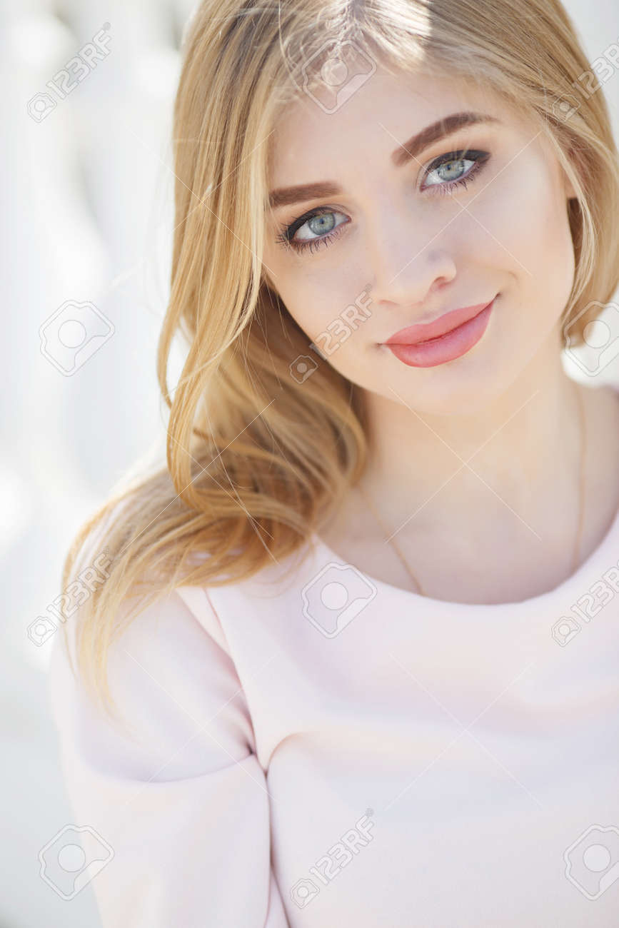 Beautiful Woman With Long Blonde Straight Hair And Grey Eyes