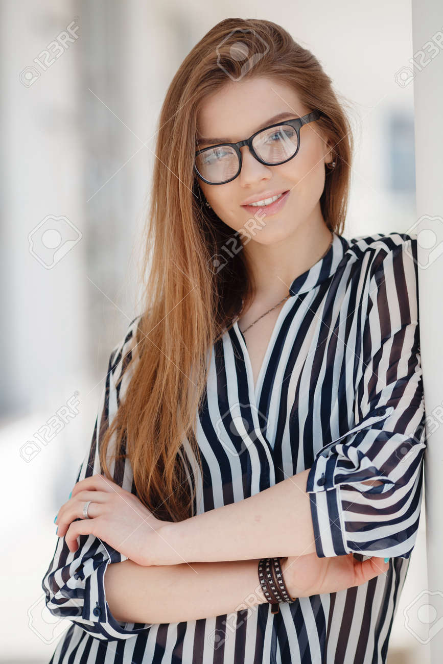 Portrait Of Happy Woman In Glasses In Spring City Blonde Long