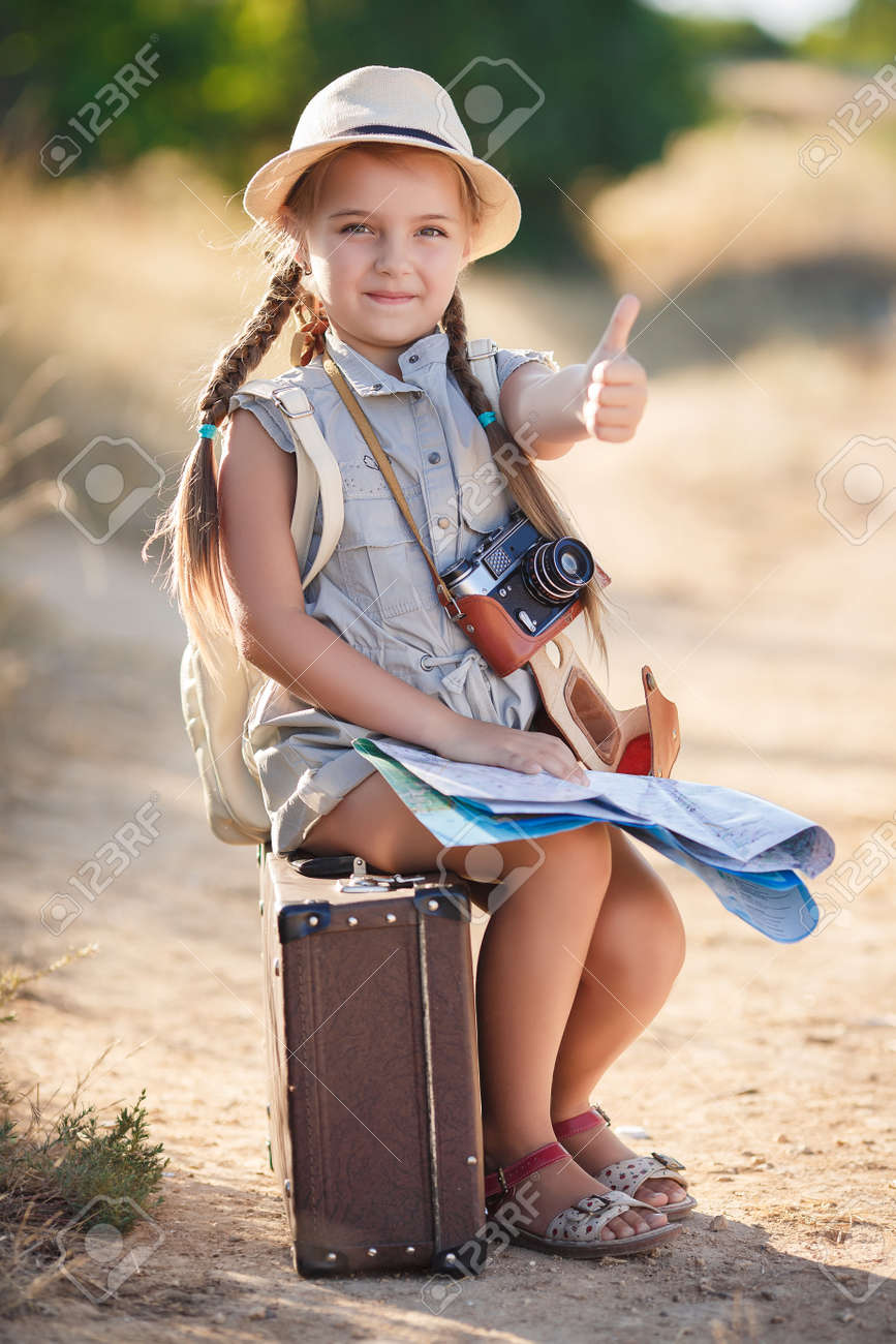 Cute Little Girl 6 Years Old Long Hair Braided Into Two Pigtails
