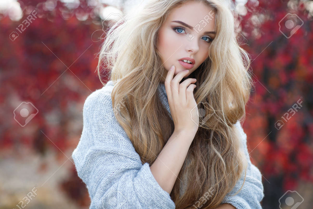 Autumn Portrait Of Beautiful Young Woman With Long Blonde Hair