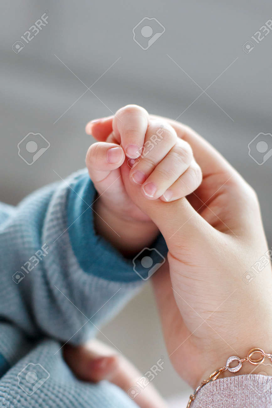 03a9eb3d1 Baby Holds Mother s Finger.A Small Pink Pen Newborn Firmly Holding ...