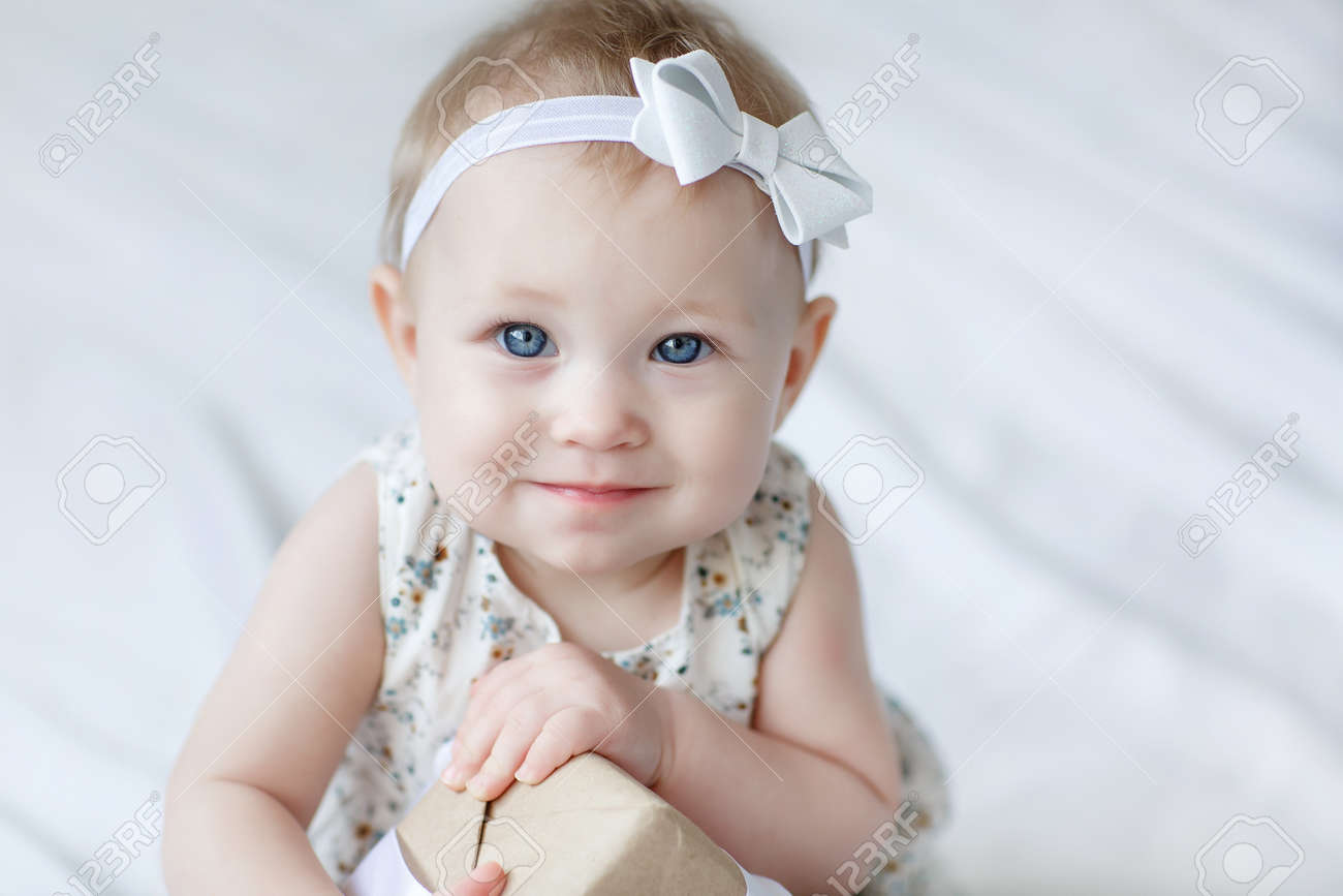 e072e5fe30e6 Close-up Of A Eight, Nine Months Old Baby Girl With Blue Eyes ...