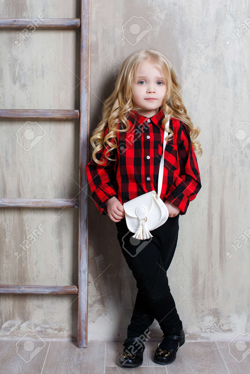 Portrait Of A Little Cute Girl With Long Wavy Hair Color Gray