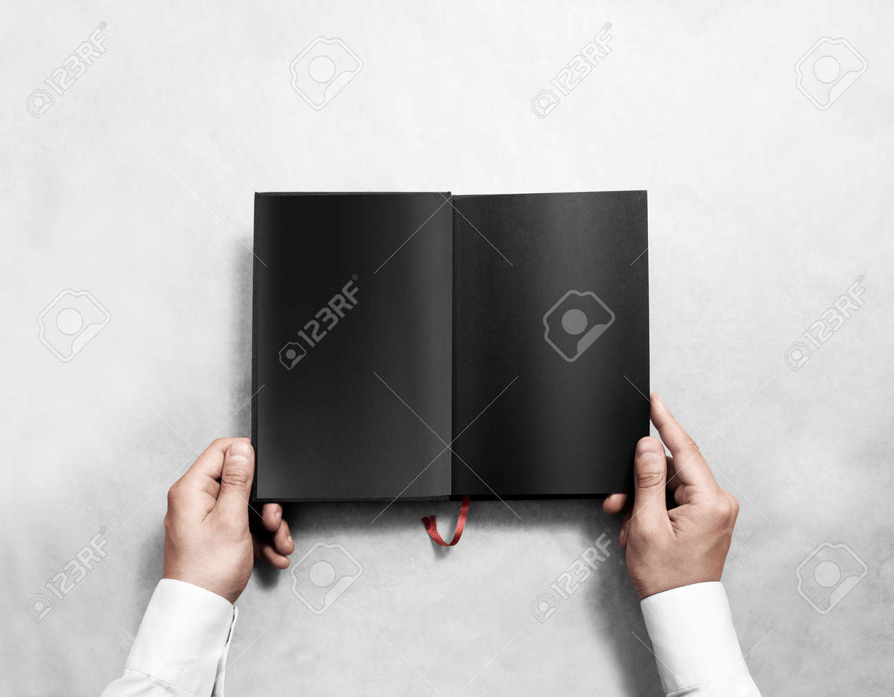 Hand Holding Blank Opened Book Mock Up With Black Pages Person