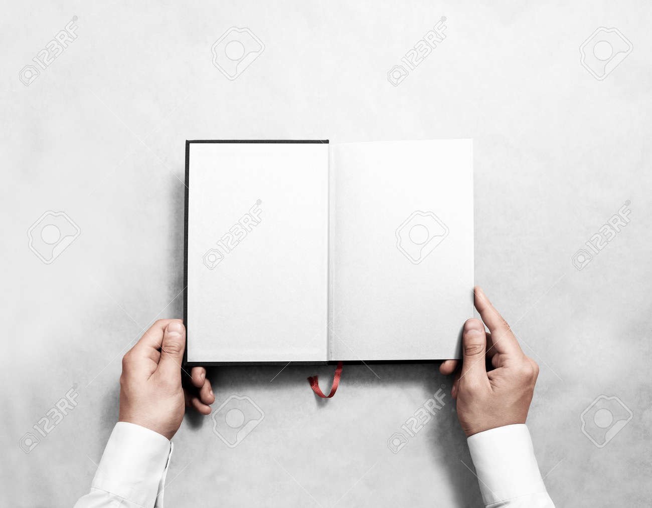 Hand Holding Blank Opened Book Mock Up With White Half Title