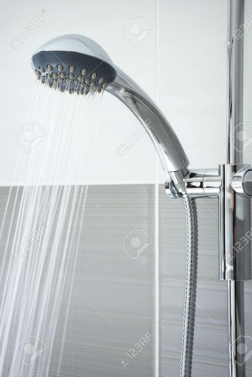 Water Pouring Out Of The Shower Head In The Bathroom Stock Photo ...
