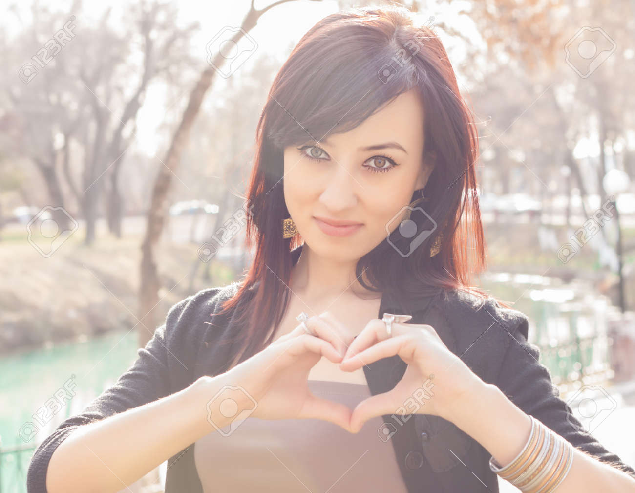 young beautiful smile with hands form heart shape gesture