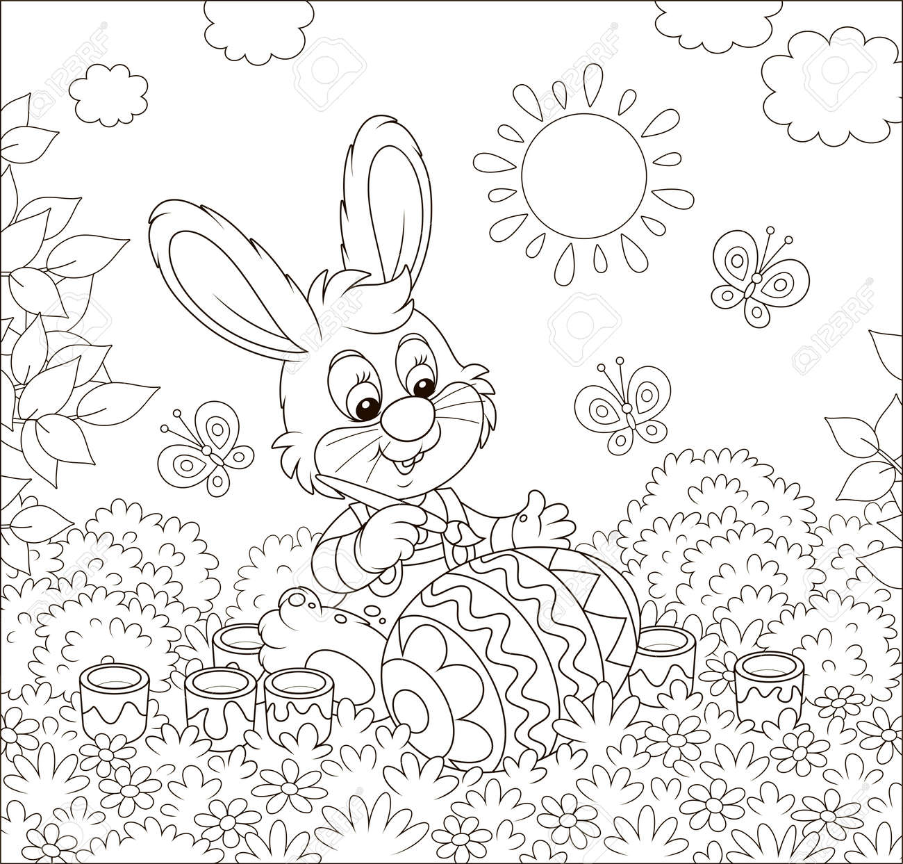 Little bunny coloring a big Easter egg on grass among flowers..