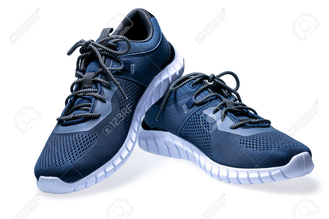 Pair of new dark blue sneakers isolated on white background. - 159263862
