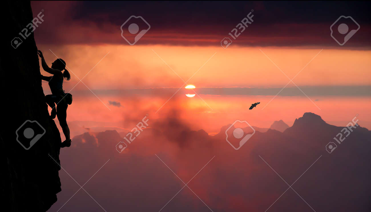 Female rock climber and mountain sunset Silhouette of elegant female extreme climber surrounded by alpine landscape bright red sunset - 44259251