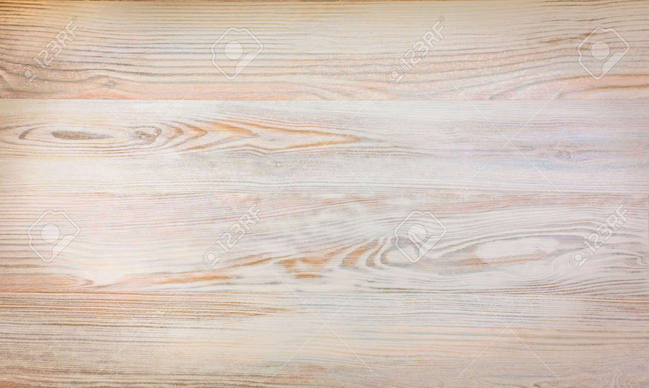 Wood plank warm brown texture background Close up image of raw wooden texture birch oak warm colours some corner vignetting copy space centre of field - 44625333
