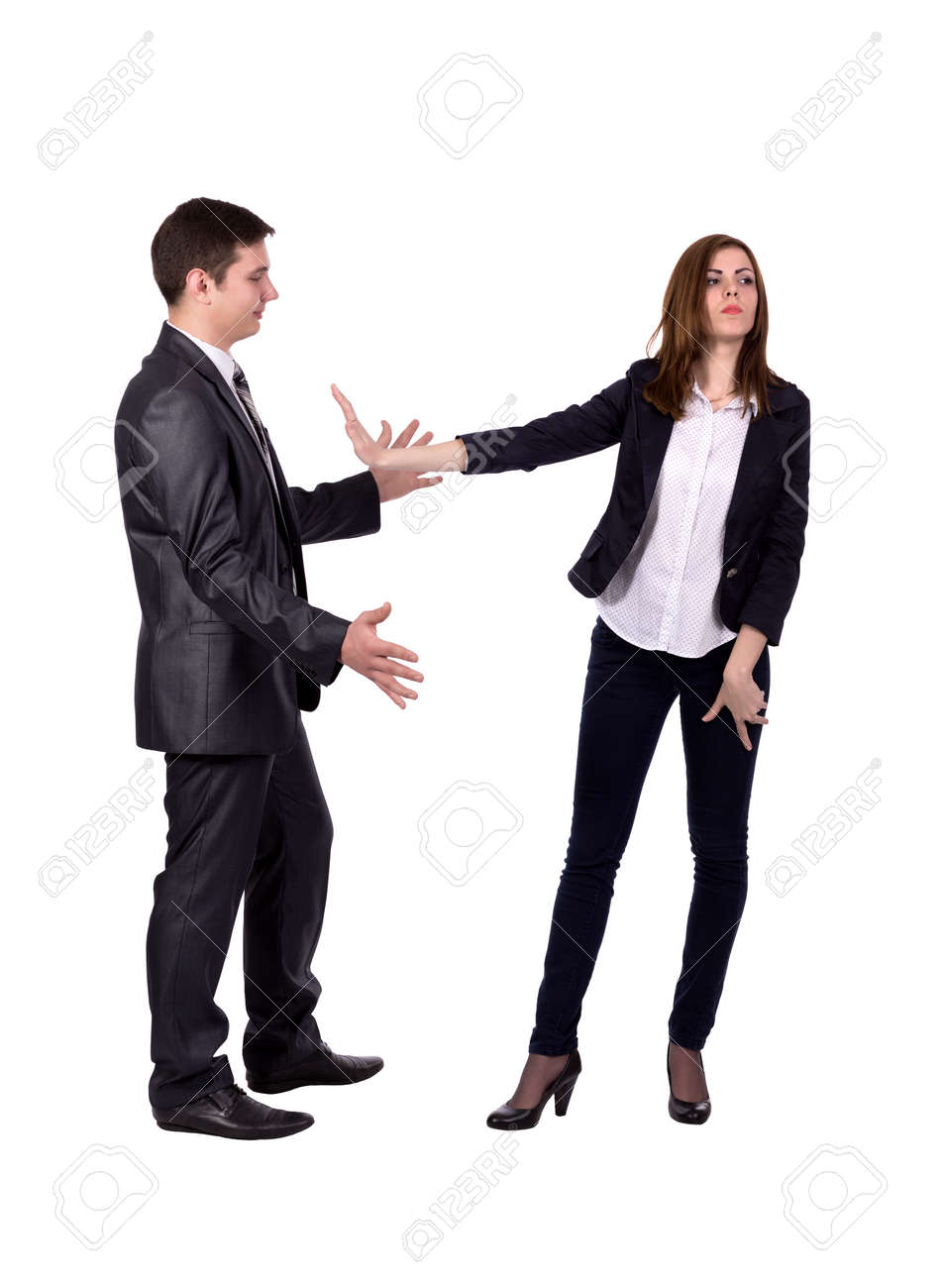 Stop harassment Image of two young adult people. Man attempts to harass lady, she expresses strong rejection gestures. Official dress code, white background, full body - 44976374