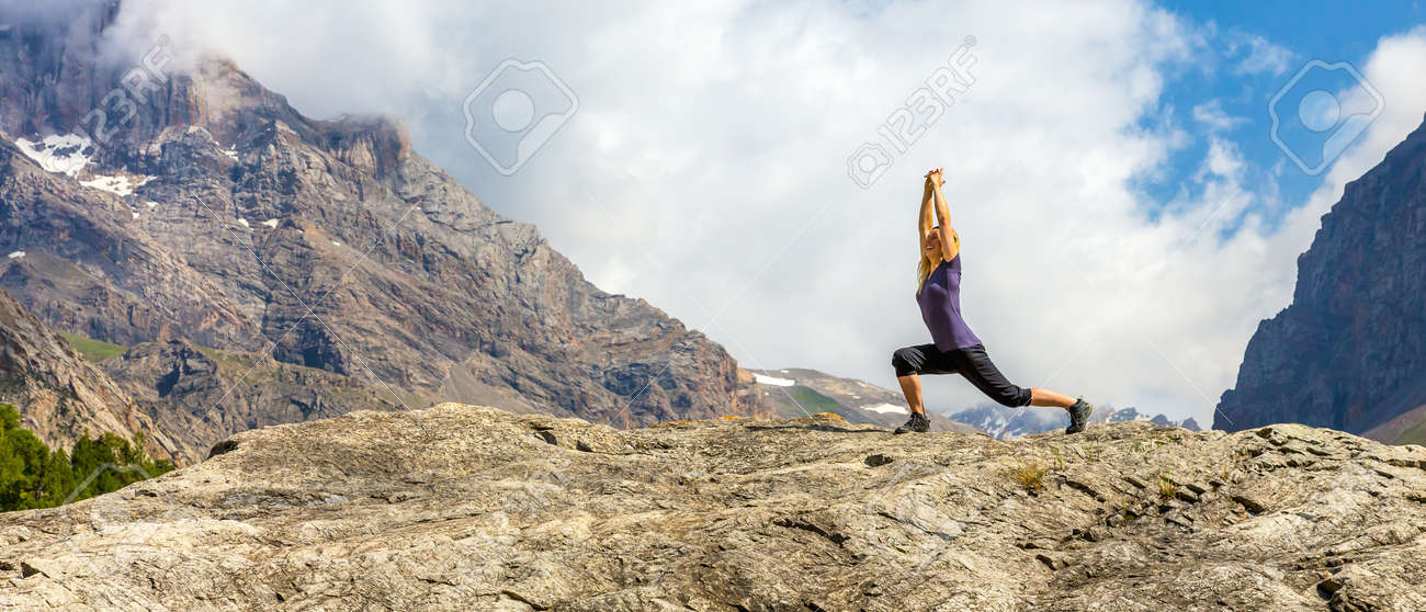 Young woman doing morning fitness outdoor in mountain landscape - 52473124