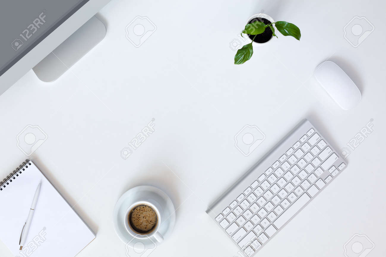 Large white office desk Office Layout Stock Photo Top View Of Modern Technology Working Place On White Office Desk With Large Desktop Computer Coffee Mug Keyboard And Mouse Green Flower Furniturefactor Top View Of Modern Technology Working Place On White Office Desk