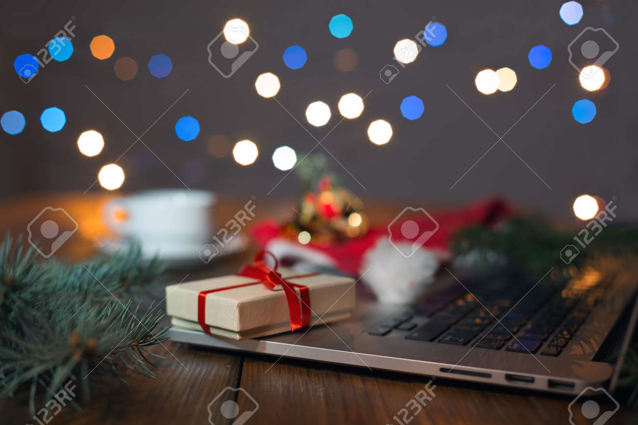 greetings throw internet gift box computer and christmas lights stock photo 74074528