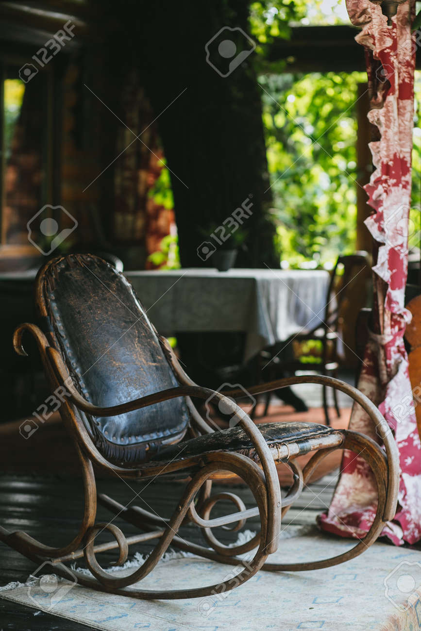 Swell Old Vintage Leather Rocking Chair On The Summer Veranda Bralicious Painted Fabric Chair Ideas Braliciousco