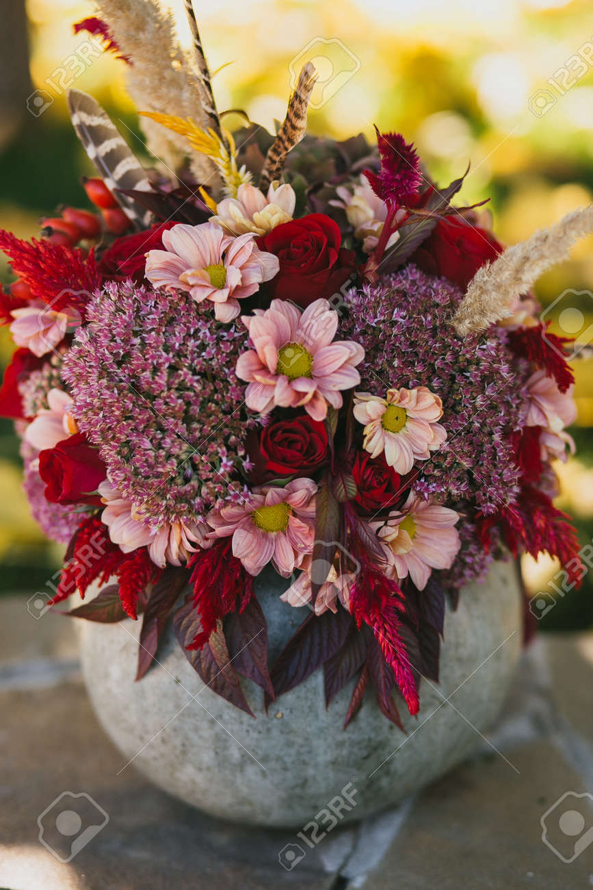 Beautiful Red Autumn Bouquet Of Roses Chrysanthemums And Feathers Stock Photo Picture And Royalty Free Image Image 92162617