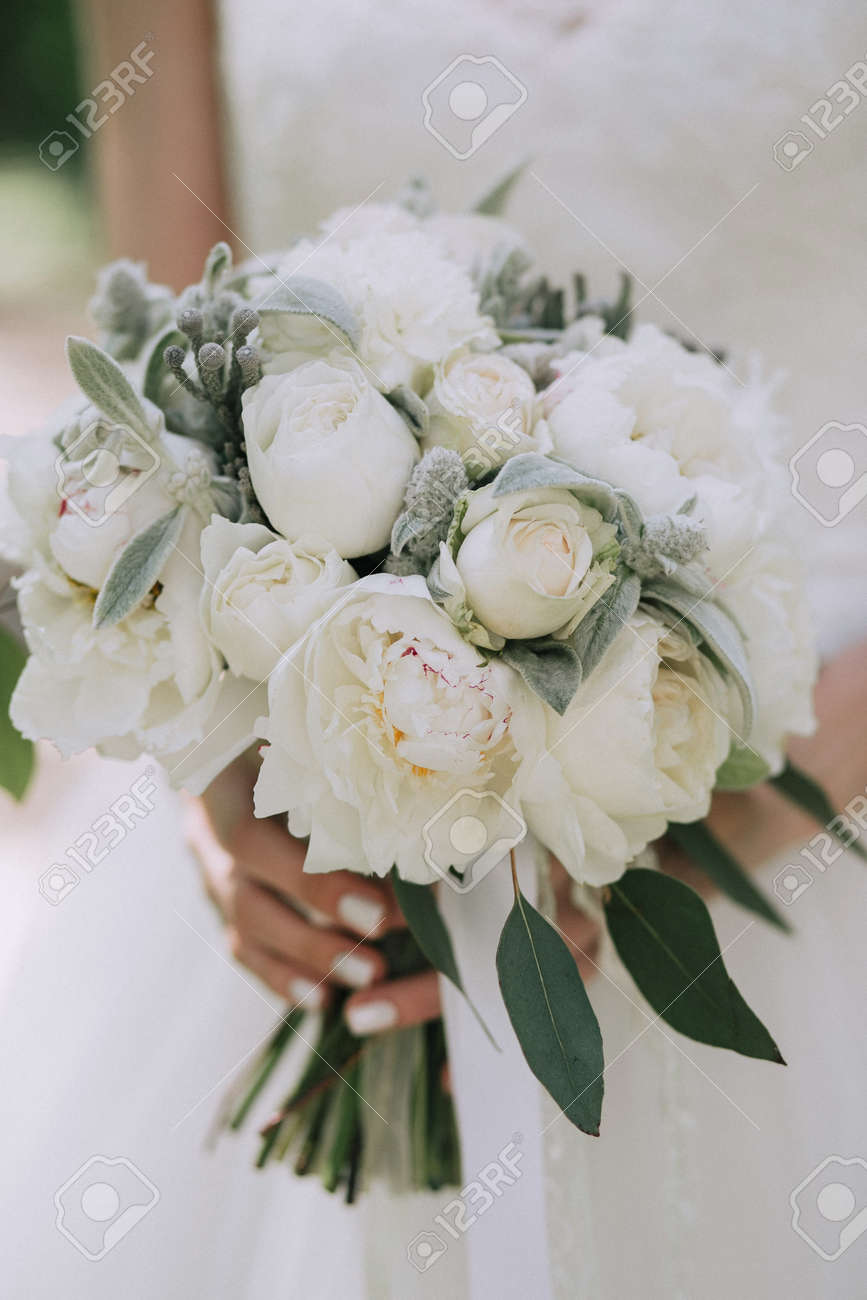 Beautiful Elegant Wedding Bouquet Of White Peonies In The Hands