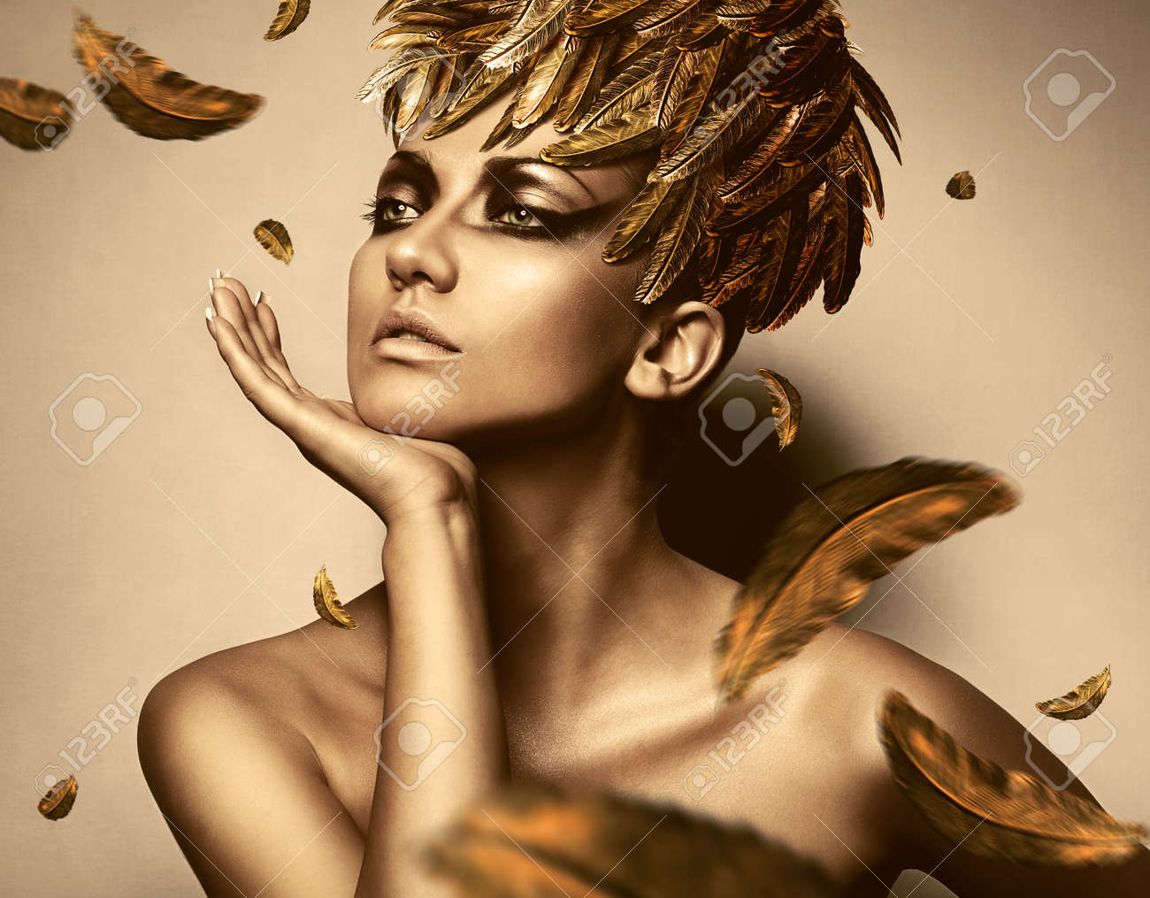 woman in feather gold hat - 31120673