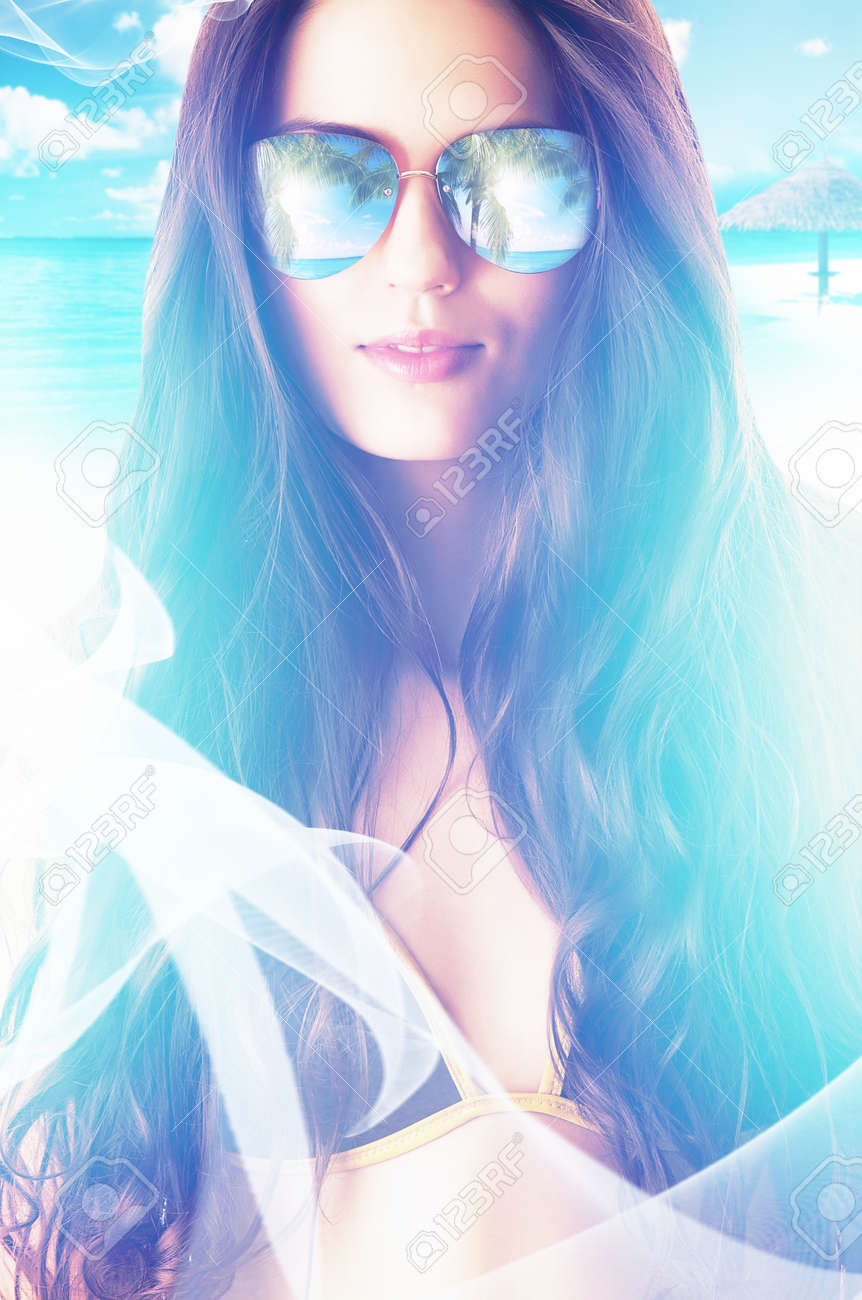 close-up portrait of woman in sunglasses on the beach - 33258621