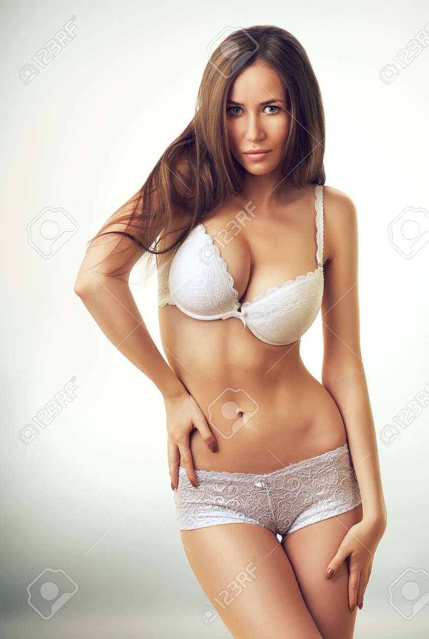 6e9a26a18f7 sexy beautiful woman in white lingerie Stock Photo - 33159593