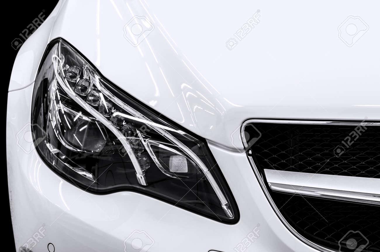 Closeup headlights of business car Car exterior detail - 29100108