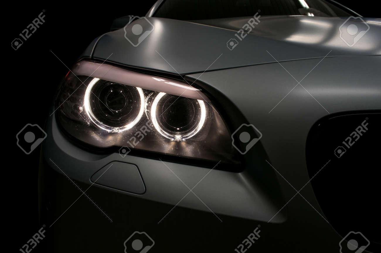 Car headlights. Exterior detail. - 34005985