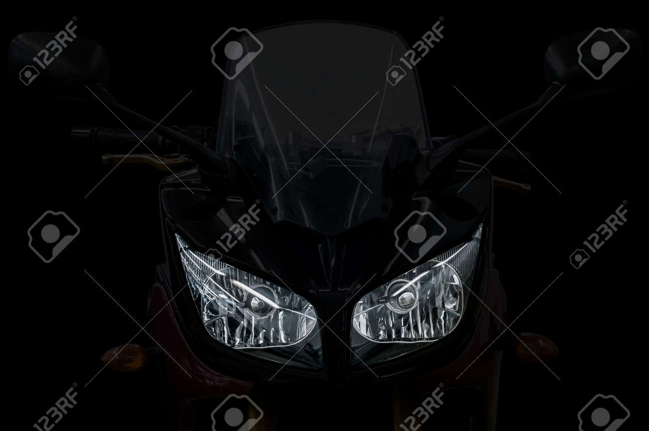 Modern motorcycle head light with two bulbs. - 38782829