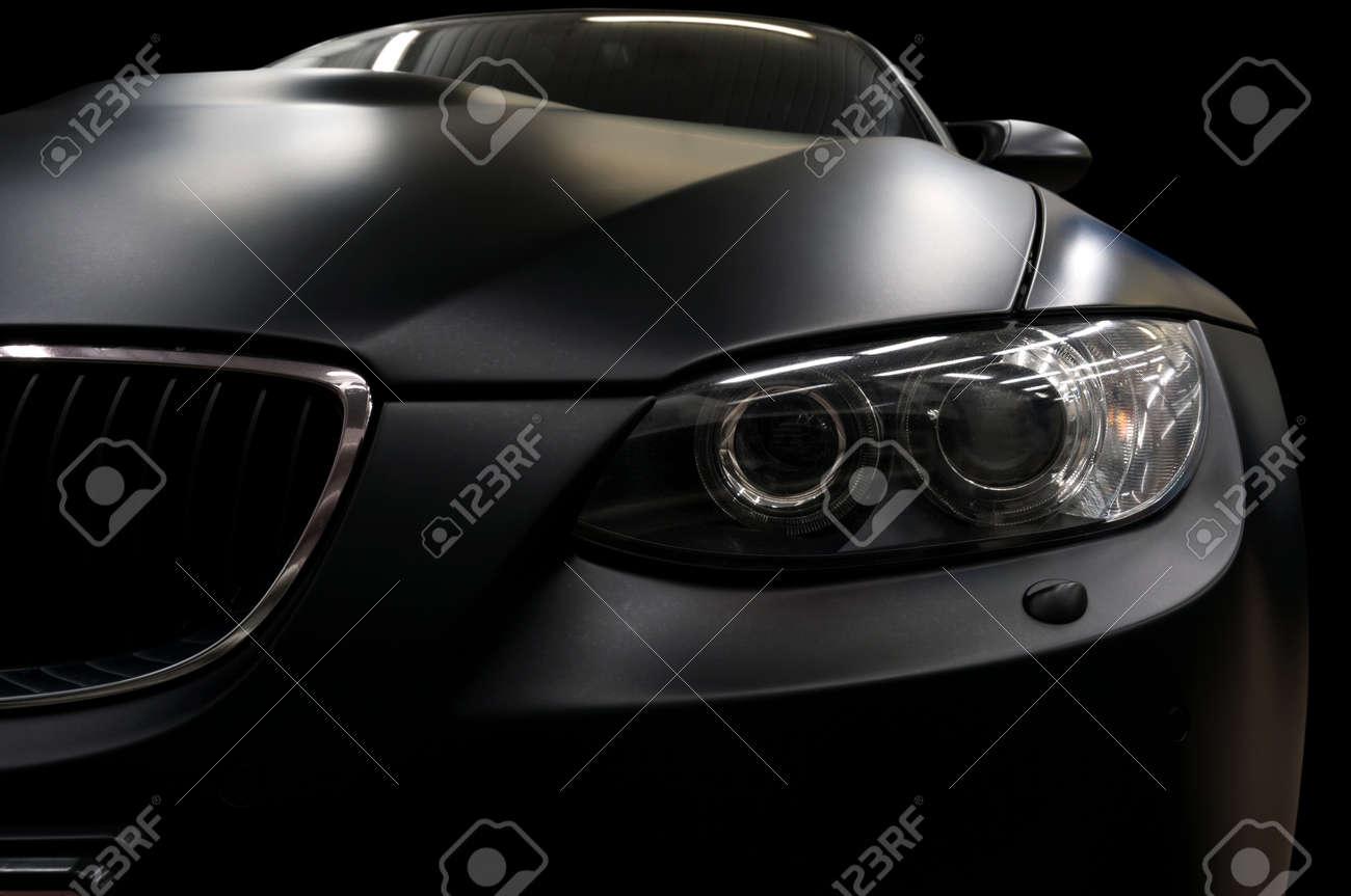 Modern car headlights. Exterior detail. - 43887752