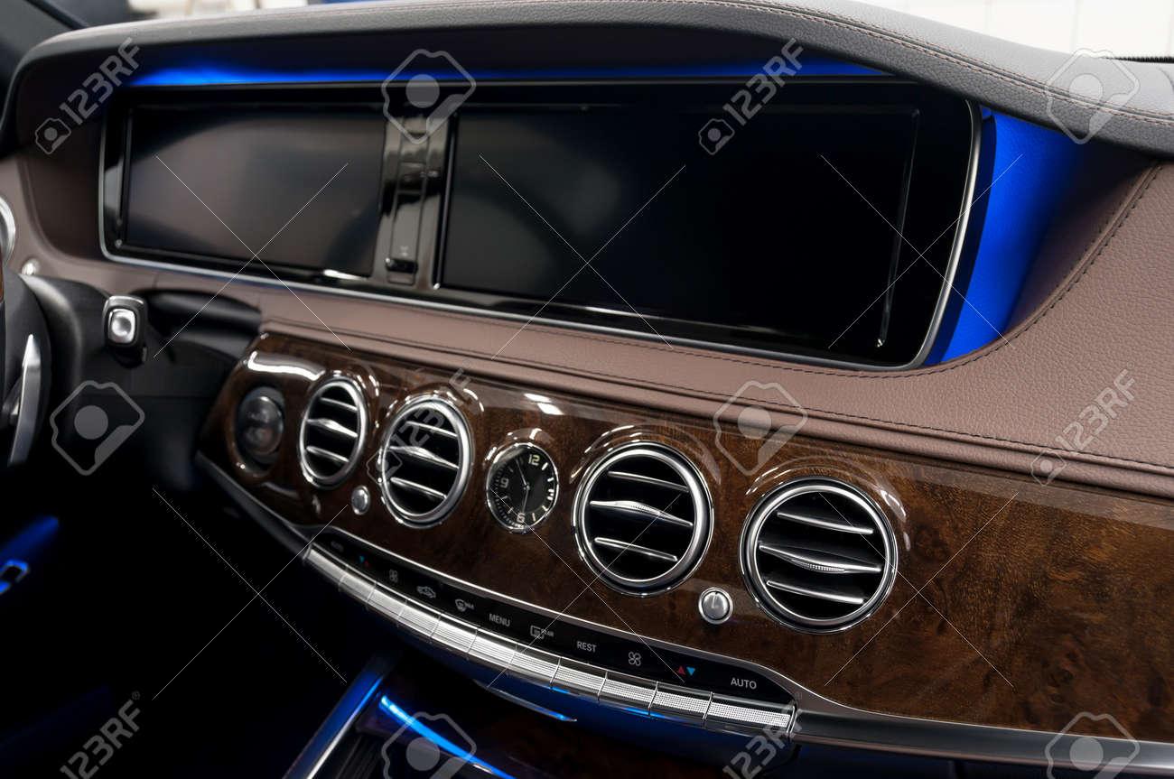 Modern car dashboard. Air conditioning system. Interior detail. - 51287515