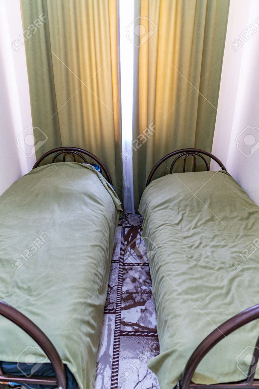 Hostel Simple Twin Bedroom With Orange Colored Curtain Linen Stock Photo Picture And Royalty Free Image Image 133160083