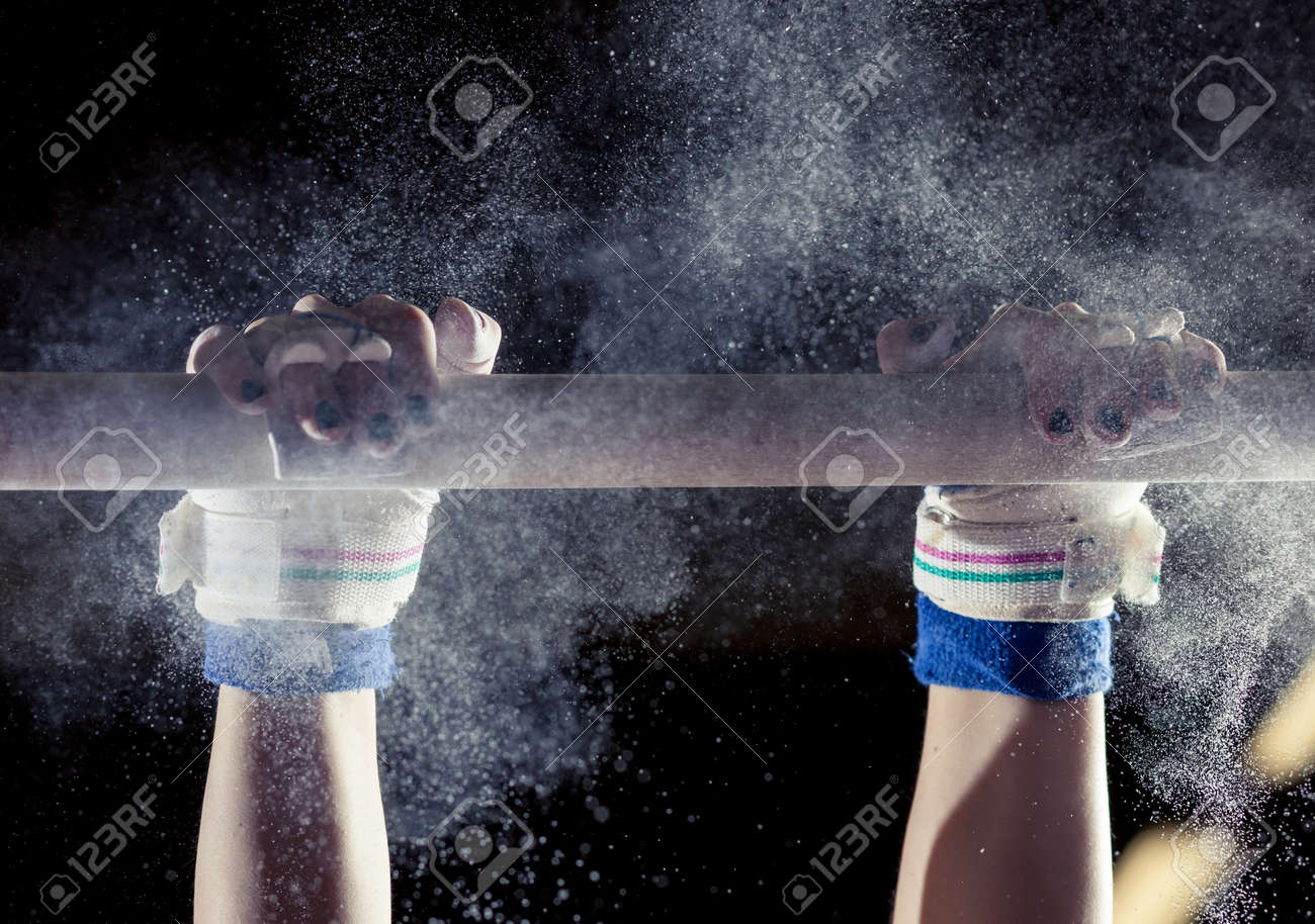 hands of gymnast with chalk on uneven bars - 36974048