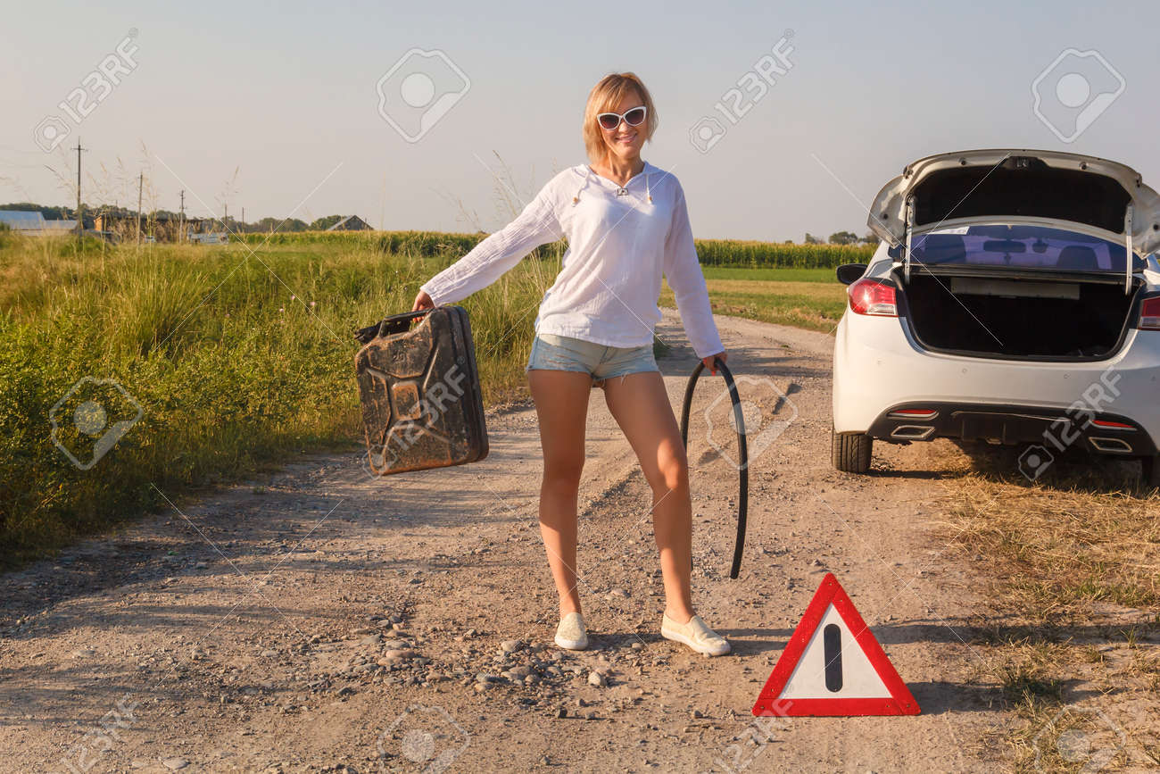 the beautiful girl driver in the car ran out of fuel and she stock photo picture and royalty free image image 105950198 the beautiful girl driver in the car ran out of fuel and she