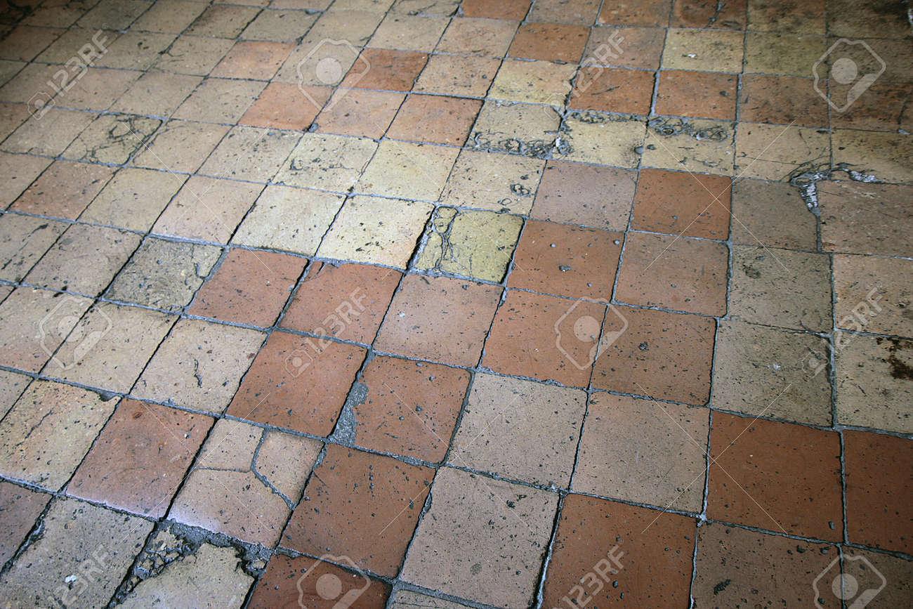 Old cracked ceramic floor tiles terracotta color stock photo old cracked ceramic floor tiles terracotta color stock photo 58447432 dailygadgetfo Images