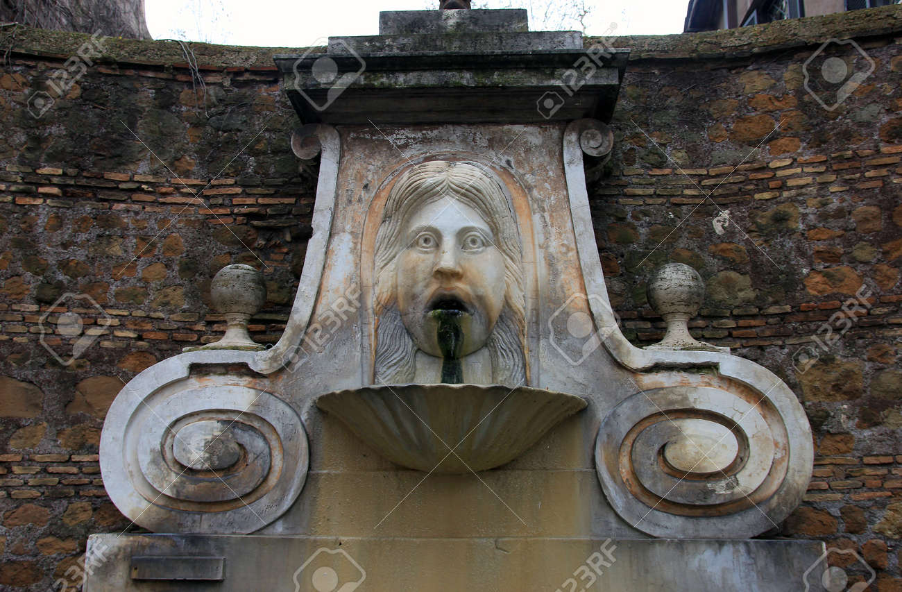 Medieval Roman Marble Fountain With Funny Bas Relief Face In Stock