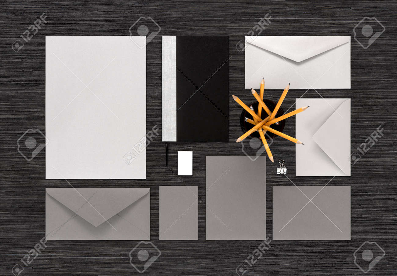 Template for corporate branding identity mockup consist of paper mockup consist of paper envelopes business card notebook pencils eraser binder clip for design presentations or portfolio top view on black table reheart Choice Image
