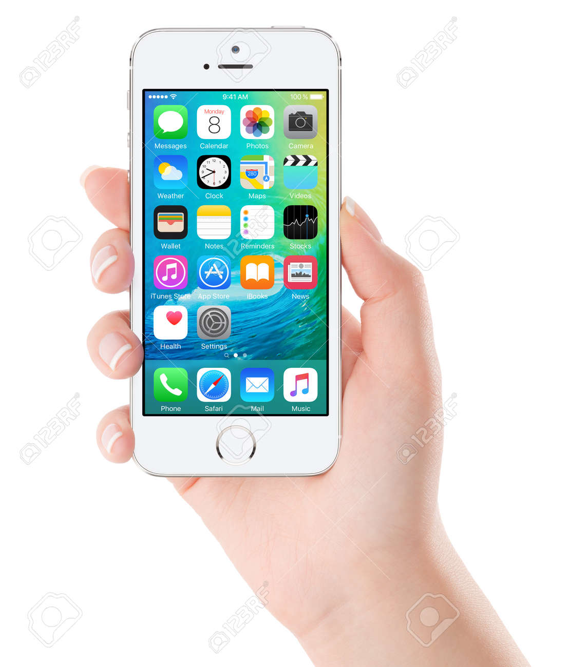 iOS 9 homescreen on the white Apple iPhone 5s display in female hand. iOS 9 is a mobile operating system created and developed by Apple Inc. Isolated on white background. Bulgaria - February 02, 2015. - 43260262